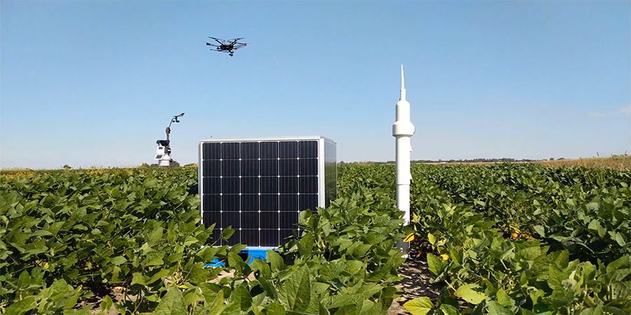 Drone above field of soybeans with monitoring equipment