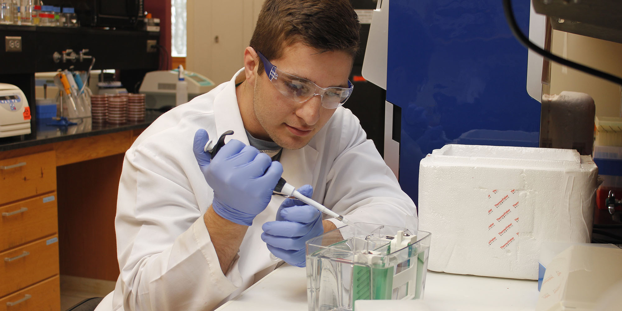 Graham Redweik working in a research lab