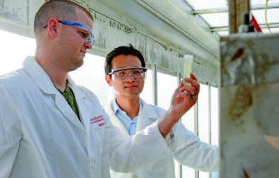 Two people in lab coats at Iowa State Agriculture Experiment Station