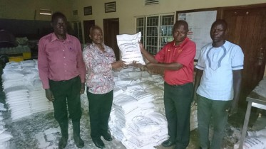 Group of men pictured during rice donation