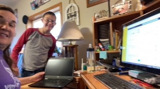Barb Clawson and her son working from home