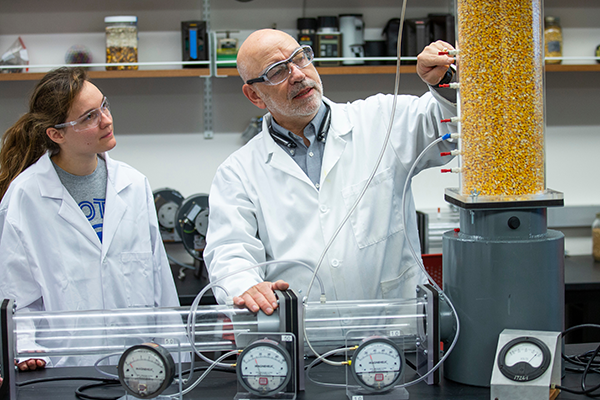 Professor and student in lab