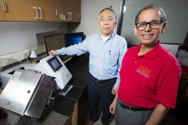 researchers with device