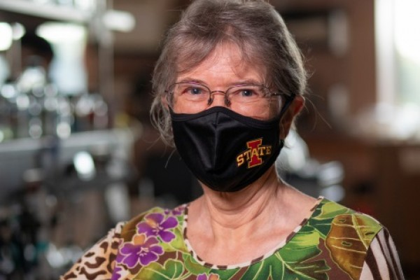 Image of woman wearing face covering with ISU logo