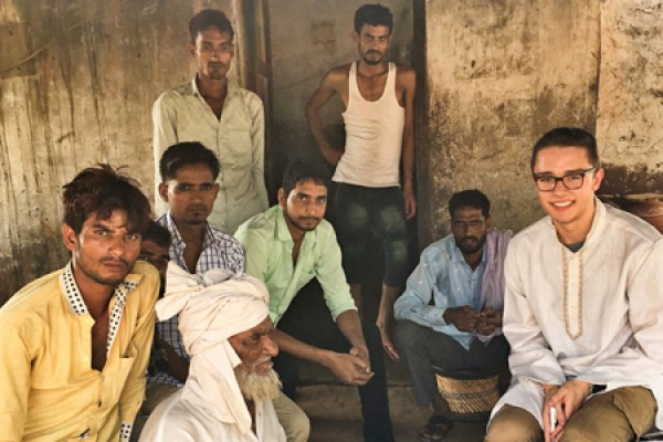Nick Battles pictured with group of men in India