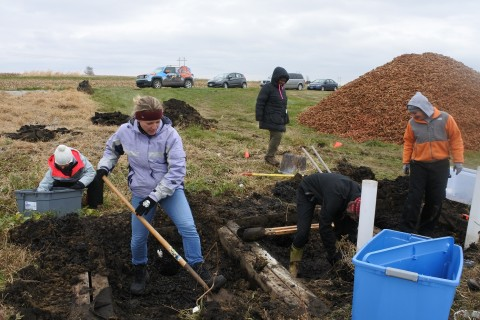 Professor Michelle Soupir (in purple jacket) working at Iowa State University bioreactor research site with students.