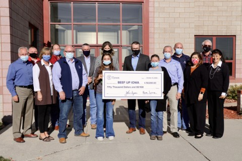 Group of people representing Tyson Foods and the Beef Up Iowa program, pictured holding a large check