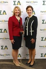 Melea Reicks Licht (left) is presented the 2018 Spirit of Ruth Award by Kim Stassen, vice president of Sigma Alpha National Sorority Board.