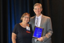 Brian Meyer (right) is presented the 2018 ACE Professional Award on August 7 by Suzanne Steel, ACE president