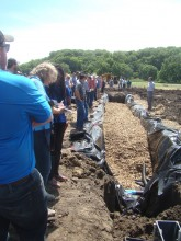 Field day group views a denitrification bioreactor installation.