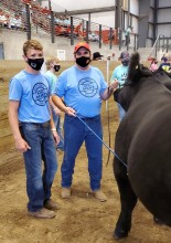 Photo of Suchan and Robison showing Suchan's steer during the show.