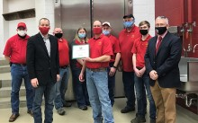 Iowa Secretary of Agriculture Mike Naig pictured standing with members of the Iowa State University Meats Laboratory.