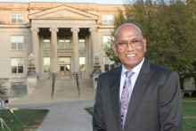 Dhamu Thamodaran standing in front of Curtiss Hall at Iowa State University