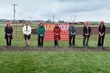 Posed photo of individuals at a groundbreaking ceremony for Iowa State University's new turkey teaching and research facility