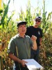 Two scientists in fall corn field