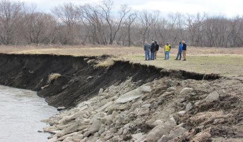 Researchers at site of streambank erosion